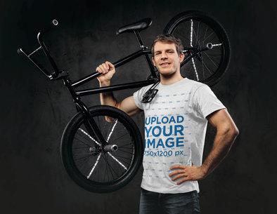 T-Shirt Mockup of a Man Holding a Sports Bike 43163-r-el2