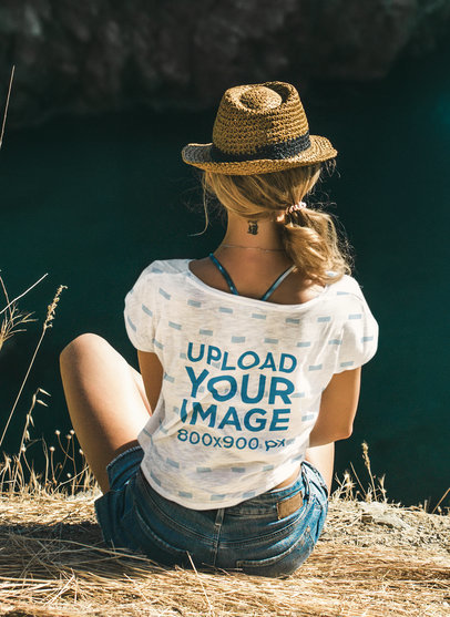 Back-View T-Shirt Mockup of a Woman Sitting Outdoors 42164-r-el2