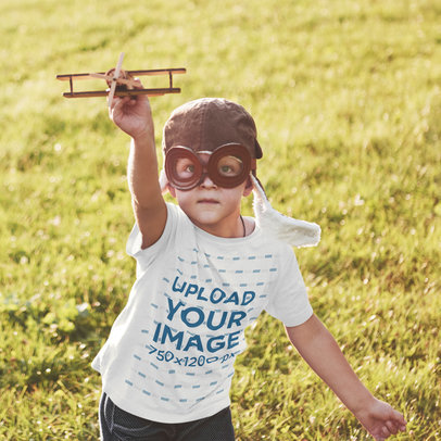 T-Shirt Mockup Featuring a Kid Playing With a Small Plane 46215-r-el2