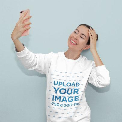 Sweatshirt Mockup Featuring a Woman Taking a Selfie in a Studio 1471-r-el2