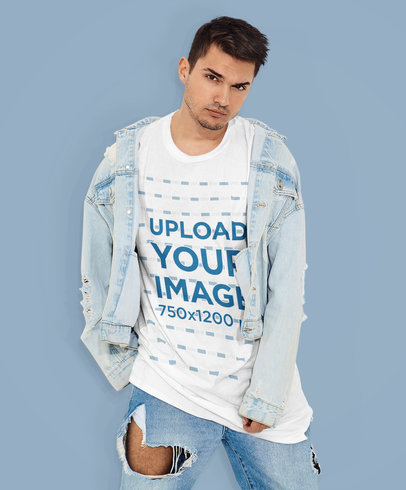 Mockup of a Young Man Posing with a Round-Neck Tee at a Studio m1338-r-el2