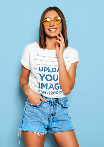 T-Shirt Mockup of a Happy Young Woman Modeling a Fresh Outfit in a Studio m1359-r-el2