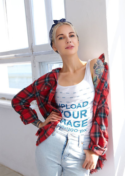 Mockup of a Tattooed Woman Wearing a Tank Top Mockup and Posing By a Window m1332-r-el2