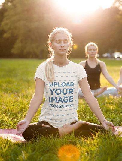 T-Shirt Mockup of a Woman Meditating Sitting on the Grass m1620-r-el2