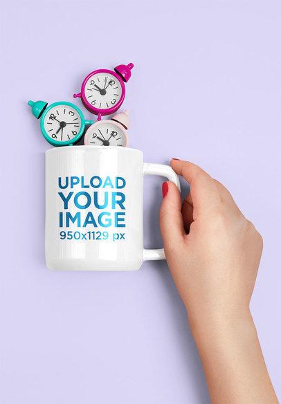 Mockup Featuring a Woman's Hand Holding an 11 oz Coffee Mug With Tiny Alarm Clocks m1967-r-el2