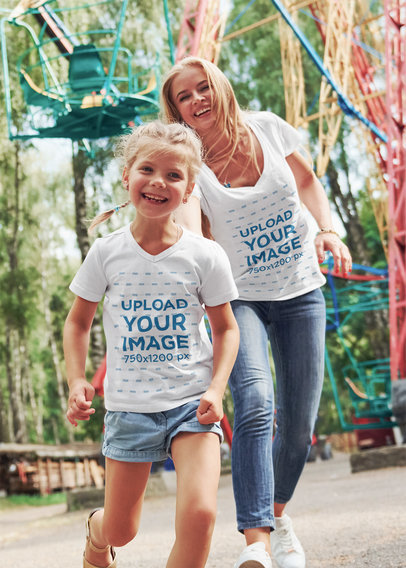 T-Shirt Mockup of a Girl Having Fun with Her Mom at an Amusement Park m1434-r-el2
