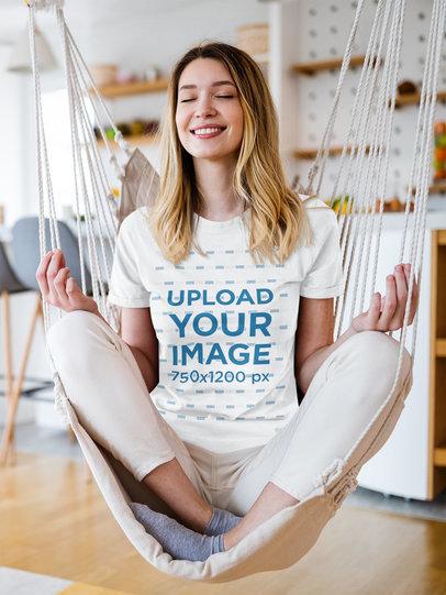 T-Shirt Mockup of a Smiling Woman Meditating on a Hammock at Home M2198-r-el2
