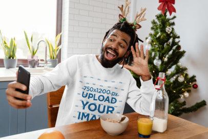 Sweatshirt Mockup of a Man Taking a Selfie During Breakfast on Christmas m1858-r-el2