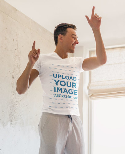 T-Shirt Mockup Featuring a Man Playfully Dancing in His Bedroom m2019-r-el2