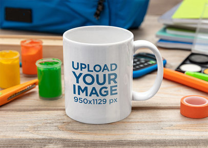 Mockup of an 11 oz Coffee Mug on an Art Table m2127-r-el2