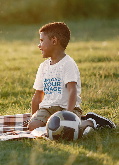 T-Shirt Mockup of a Smiling Boy at a Park with a Soccer Ball M1352-r-el2