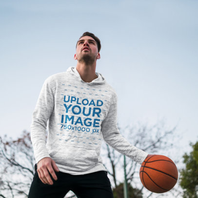 Pullover Hoodie Mockup of a Young Man Playing Basketball m1943r-el2