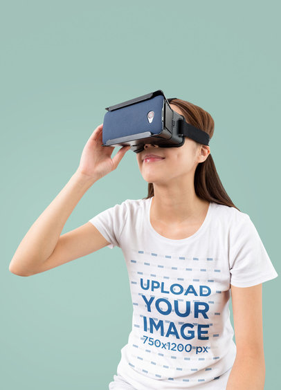 Mockup of a Woman Wearing a T-Shirt While Using a VR Device m1816-r-el2