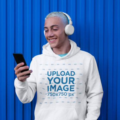 Hoodie Mockup of a Man with Bleached Hair Enjoying His Music m1971r-el2