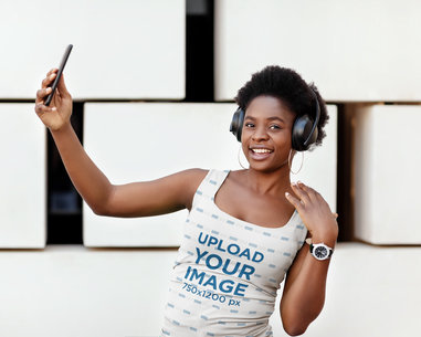 Sublimated Tank Top Mockup Featuring a Happy Woman with Headphones M2270-r-el2