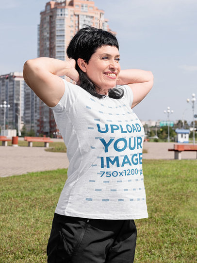 T-Shirt Mockup of a Woman Stretching Her Shoulders at a Park m1559-r-el2