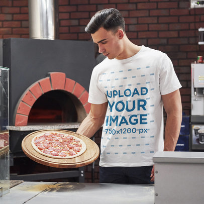Basic T-Shirt Mockup of a Serious Man Holding a Pizza m2235-r-el2