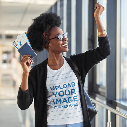 T-Shirt Mockup of a Happy Woman Holding Her Passport and Plane Tickets m2256-r-el2
