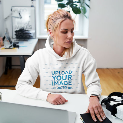 Pullover Hoodie Mockup Featuring a Woman Sitting at Home m2379-r-el2
