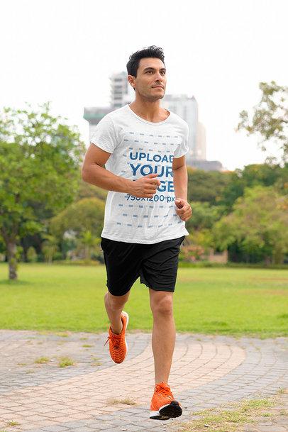 T-Shirt Mockup of a Tall Man Running at a Park m2740-r-el2