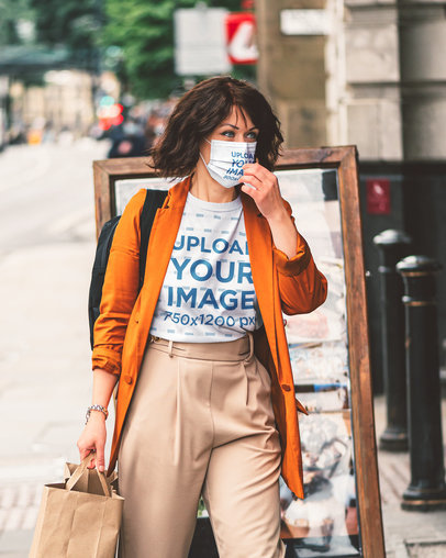 T-Shirt and Face Mask Mockup of a Stylish Woman Walking Down the Street 45429-r-el2