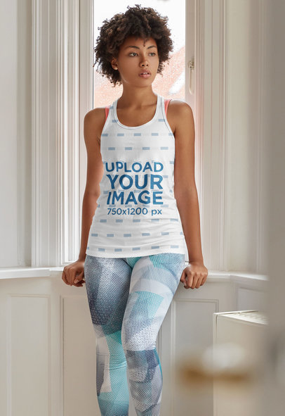 Mockup of a Woman Wearing a Sublimated Tank Top and Posing by a Window m2823-r-el2