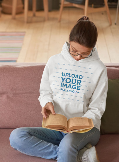 Hoodie Mockup of a Young Woman Reading on a Couch m2319-r-el2