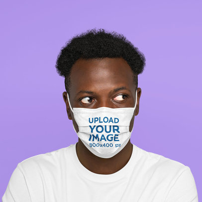 Face Mask Mockup Featuring a Curly-Haired Man Against a Plain Color Background m2228-r-el2
