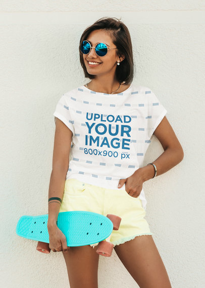 Sublimated T-Shirt Mockup of a Young Woman Holding a Small Skateboard m1612-r-el2