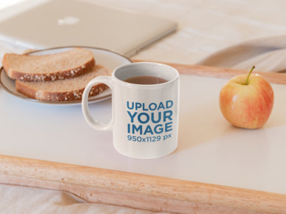 Mockup of an 11 oz Coffee Mug Featuring Bread and an Apple 33616a