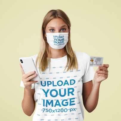 T-Shirt Mockup of a Woman With a Face Mask Holding a Credit Card m2374-r-el2