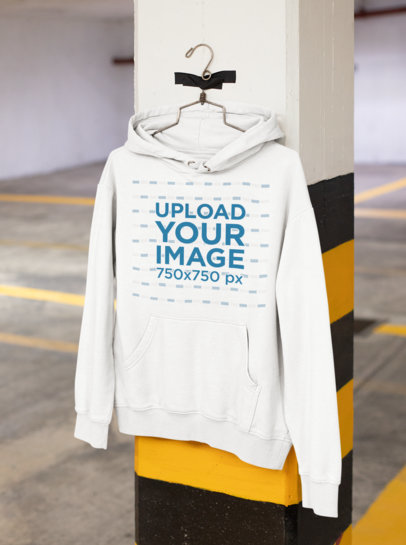 Mockup of a Hoodie Hanging From a Column m467