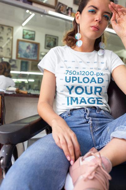 T-Shirt Mockup of a Young Woman at a Vintage Barbershop 22723a