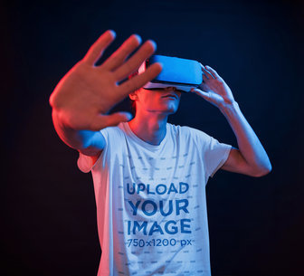 T-Shirt Mockup of a Young Man Using a VR Headset m1911-r-el2