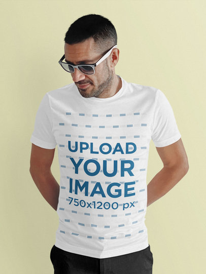 T-Shirt Mockup of a Man with Sunglasses Posing in a Studio m1796-r-el2