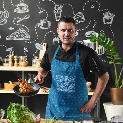 Apron Mockup Featuring a Man Cooking a Stir Fry M2934-r-el2