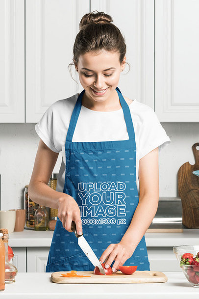 Mockup of a Happy Woman Cooking at Home While Wearing an Apron m2931-r-el