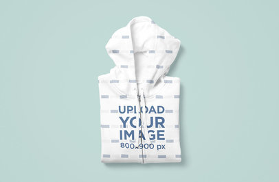 Mockup of a Sublimated Hoodie Folded Over a Flat Colored Surface 5044-el1