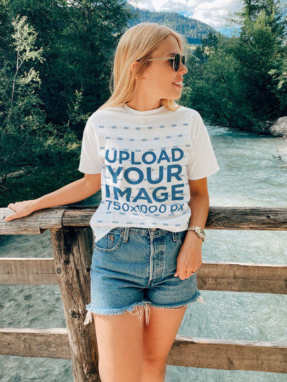 T-Shirt Mockup of a Young Woman Posing on a Wooden Bridge m1804-r-el2