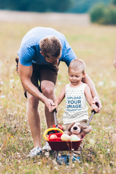 Tank Top Mockup of a Little Boy Playing Outdoors with His Dad M3120-r-el2
