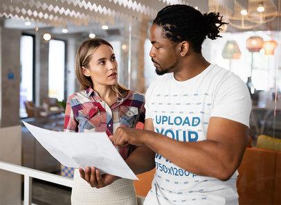 T-Shirt Mockup of a Man Checking a Design at Work 42601-r-el2