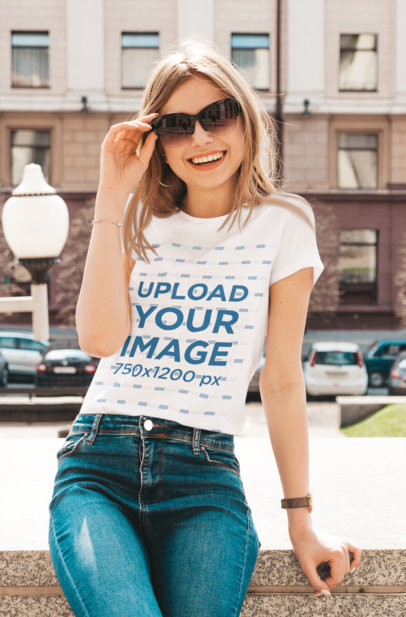 T-Shirt Mockup Featuring a Joyful Woman With Sunglasses Posing in the City m1375-r-el2