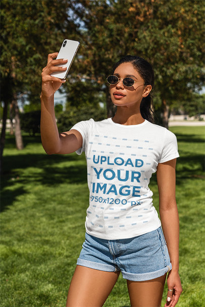 T-Shirt Mockup of a Woman Taking a Selfie at a Park 5179-el1