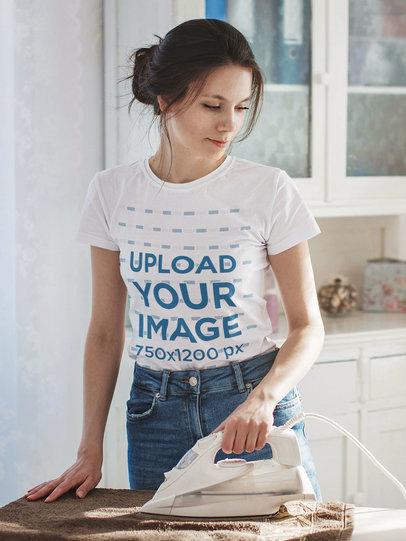 T-Shirt Mockup Featuring a Woman Ironing at Home m2260-r-el2