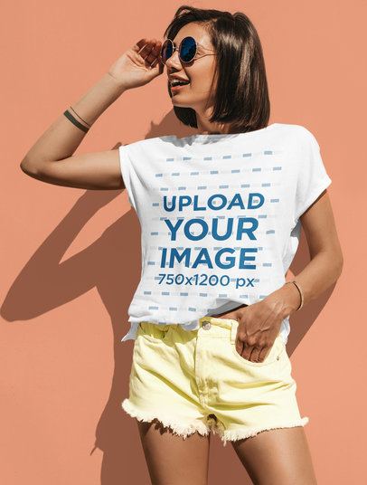 T-Shirt Mockup of a Trendy Woman Posing by a Colored Wall M1725-r-el2