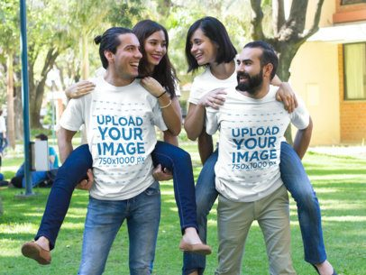 Two Guys Carrying Their Girlfriends and Wearing Different Tees Mockup Outdoors a15683