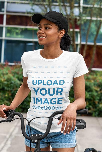 T-Shirt Mockup of a Smiling Woman Riding a Bike 5186-el1