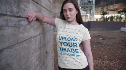 T-Shirt Video Featuring a Serious-Looking Woman by a Concrete Wall 3022