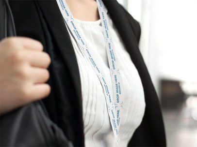 Close Up of a Young Girl Leaving the Office Wearing a Lanyard Mockup a15151