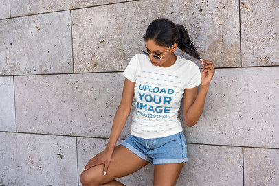 T-Shirt Mockup Featuring a Woman in a Summer Outfit Posing 5181-el1
